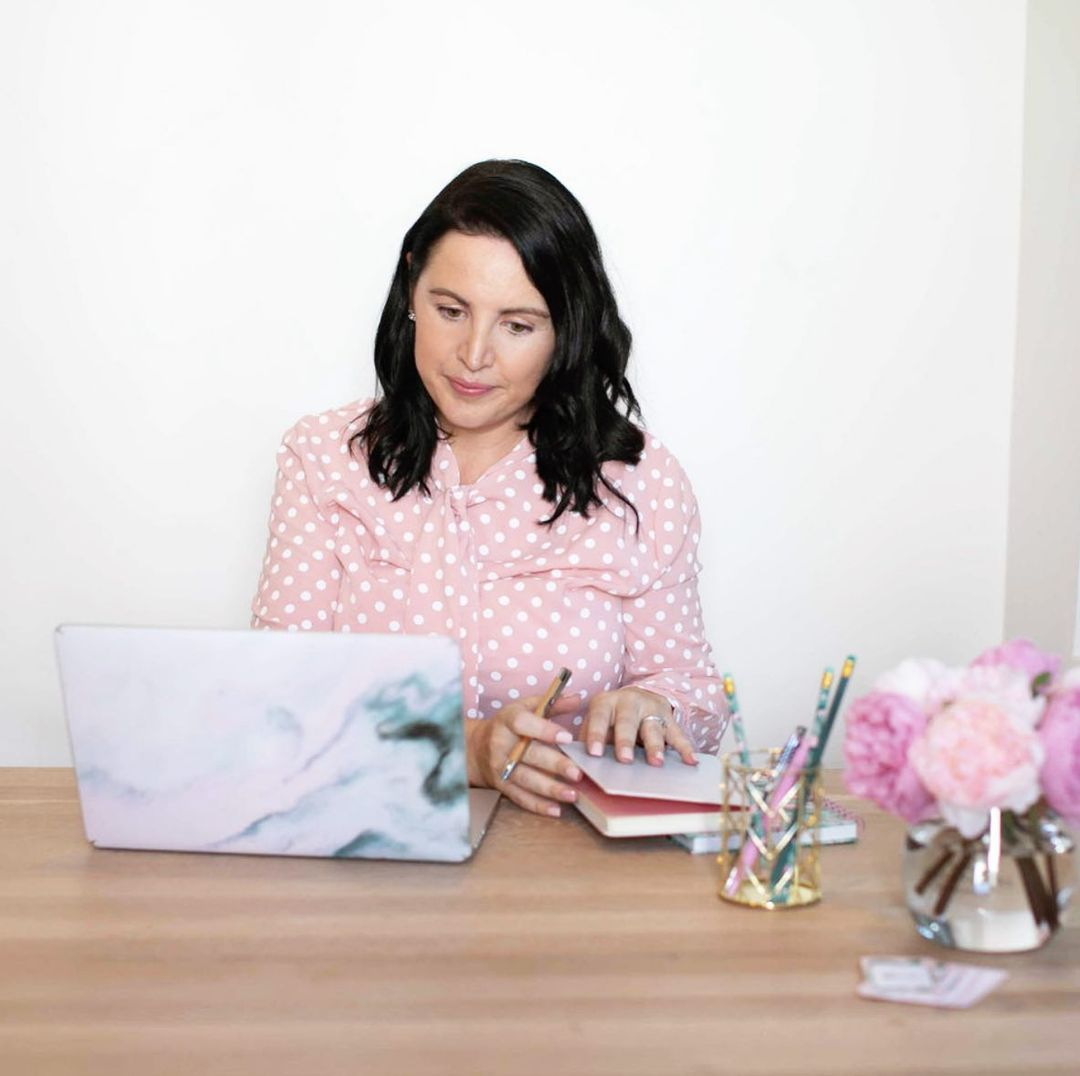 Lynn Mooney working at her laptop