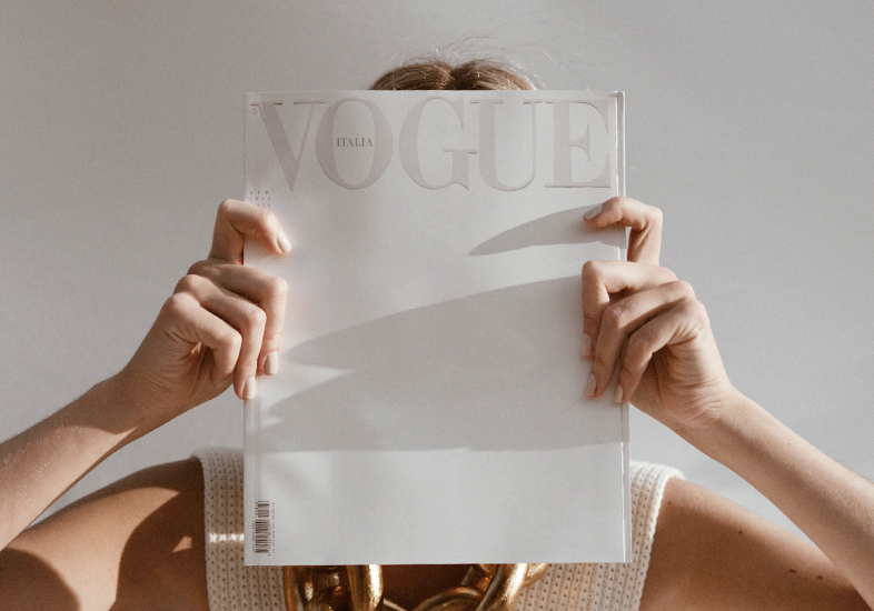Woman Holding Vogue